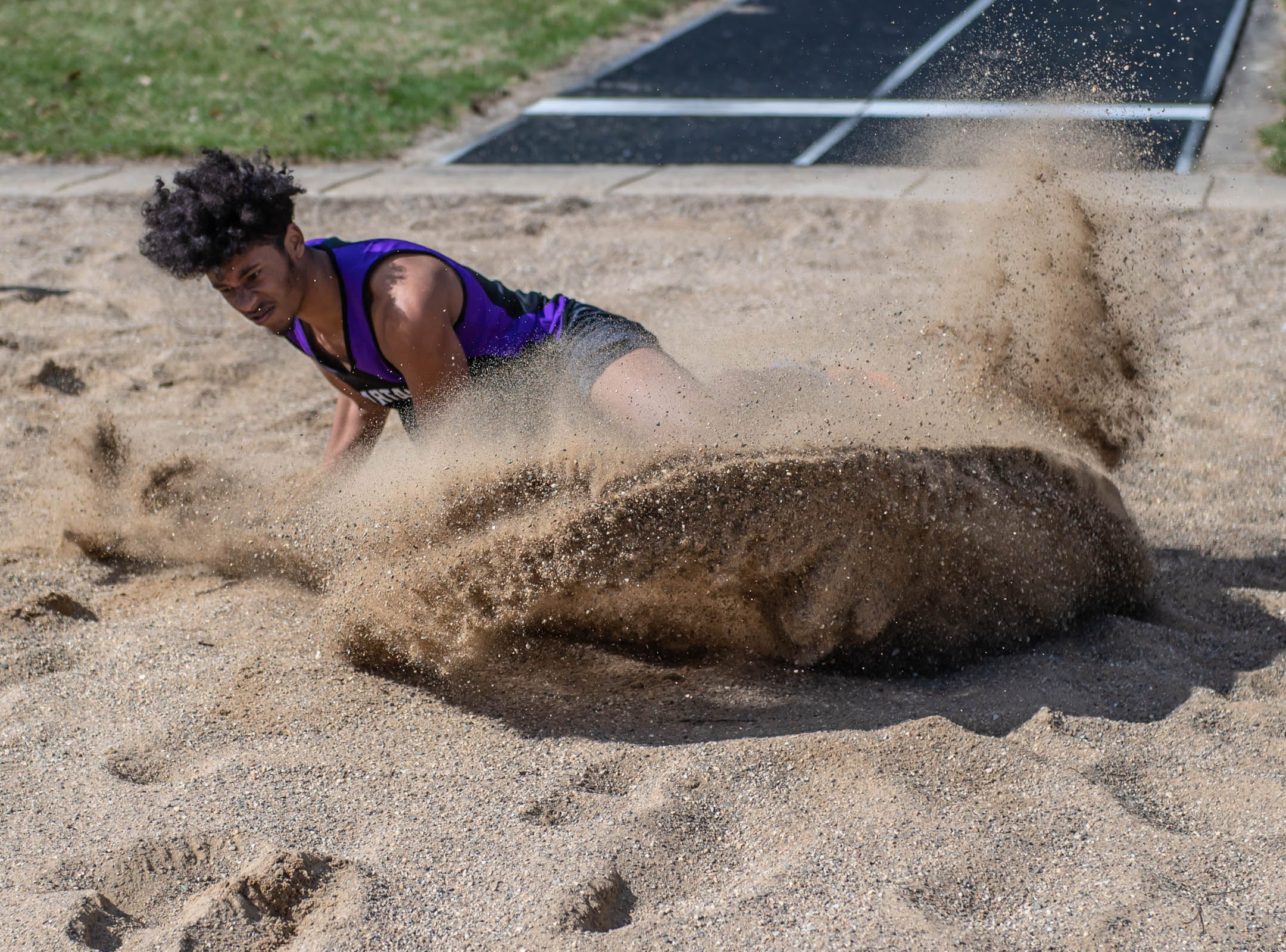 Lakeview's  Landon Bridges competes in the long jump at Lakeview High School during a dual meet held on 4/9/19.