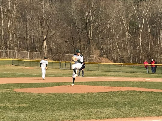 Vestal's Kyle Taborne pitches against Maine-Endwell on Thursday in a Southern Tier Athletic Conference game at Vestal. Taborne struck out 15 and the Golden Bears won, 2-1.