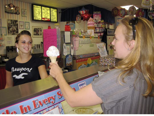 Krista Ladd (left) dishes ice cream to customer Colleen Watson (right) at Suzy-Q's at 1110 Chenango Street in 2009.