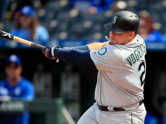 Seattle Mariners designated hitter Daniel Vogelbach hits a solo home run during the 10th inning of a baseball game against the Kansas City Royals at Kauffman Stadium in Kansas City, Mo., Thursday, April 11, 2019. The Mariners defeated the Royals 7-6 in 10 innings.