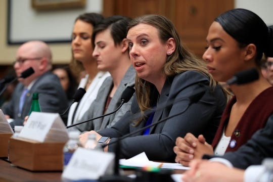 """FILE- In this Feb. 27, 2019 file photo, Army Staff Sgt. Patricia King, second from right, together with other transgender military members, from left, Navy Lt. Cmdr. Blake Dremann, Army Capt. Alivia Stehlik, Army Capt. Jennifer Peace and Navy Petty Officer Third Class Akira Wyatt, testify about their military service before a House Armed Services Subcommittee on Military Personnel hearing on Capitol Hill in Washington. A new Trump administration regulation set to go into effect Friday, April 12,  directs military secretaries to kick out transgender service members who refuse to serve in their birth sex and """"given an opportunity to correct those deficiencies."""" (AP Photo/Manuel Balce Ceneta, File)"""