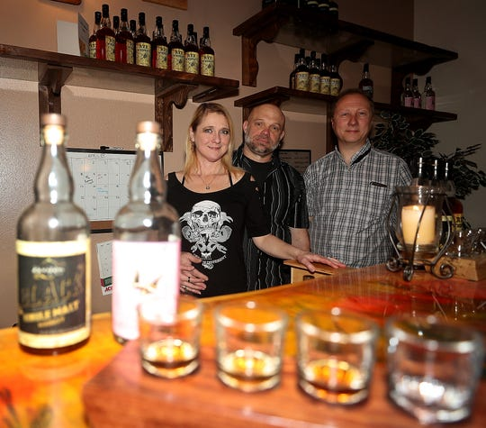 Heather Martin, husband Tom Martin and Chris Schien at their  Black Ring Spirits in Port Orchard on Wednesday, April 10, 2019.