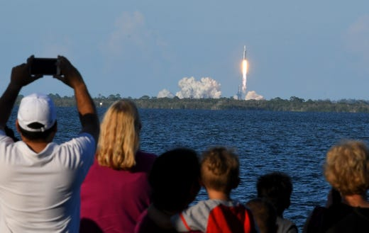 The launch of the SpaceX Falcon Heavy from the Kennedy Space Center Pad 39A from Port St. John along the shoreline of the Indian River in Brevard County