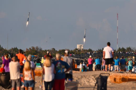 Falcon Heavy's side boosters return to Cape Canaveral Air Force Station on Thursday, April 11, 2019.