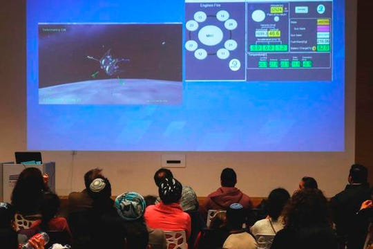 People watch a screen showing explanations of the landing of Israeli spacecraft, Beresheet's, at the Planetaya Planetarium in the Israeli city of Netanya, on April 11, 2019 before it crashed during the landing. (Photo by JACK GUEZ / AFP)JACK GUEZ/AFP/Getty Images