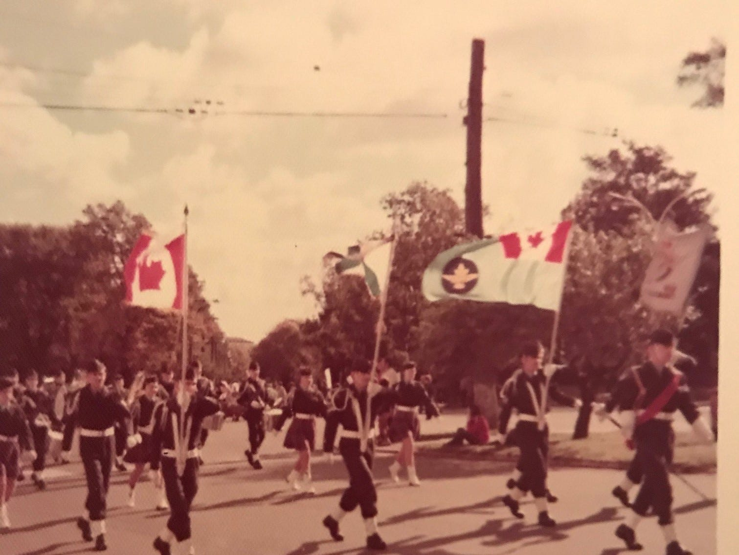 Where did this parade, complete with the flag of Canada, take place - and who put it in a photo album found in Melbourne, Florida, in 2011?