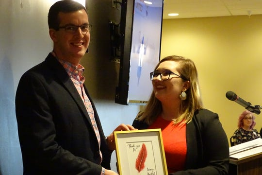 Agent Logan Kirk of Dostal & Kirk, Inc., accepts the Live United Community Spirit Award award from Nadia Oehler, United Way Crawford County manager, during the annual recognition breakfast Thursday morning at Trillium Event Center.