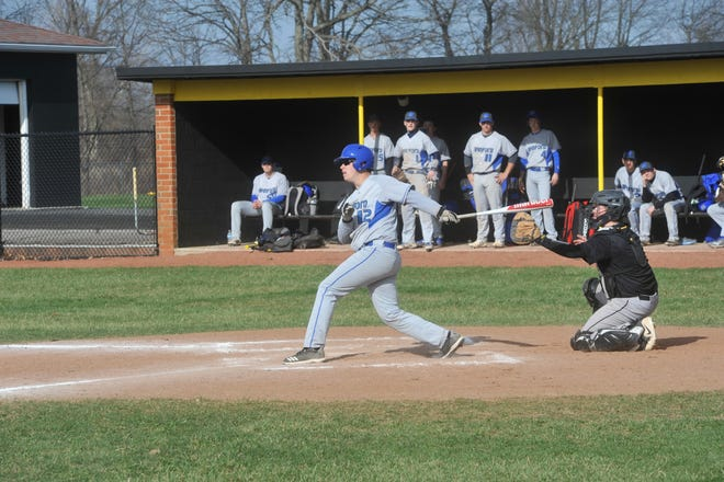 Wynford's Zach Harer watches his hit soar wide of the foul line.