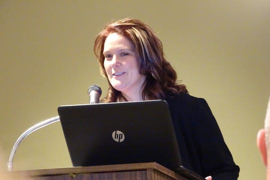 Amber Wertman, United Way of North Central Ohio executive director, speaks during the annual recognition breakfast Thursday morning at Trillium Event Center.