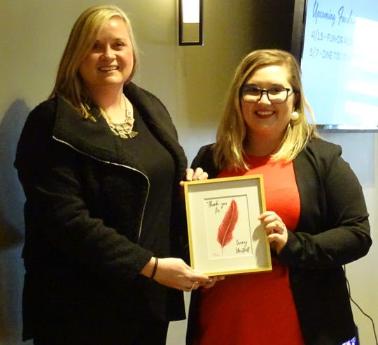 Melinda Teynor, left, is presented the Sustaining Advocate award by Nadia Oehler, United Way Crawford County manager, during the annual recognition breakfast Thursday morning at Trillium Event Center.
