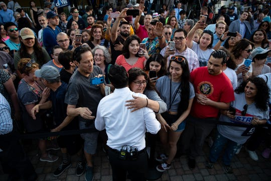 Presidential candidate Julian Castro hugs an audience member after holding his People First rally in San Antonio, Texas on Wednesday, April 10, 2019. Earlier in the day President Trump hosted a fundraiser in San Antonio.