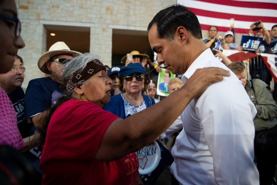 A women prays with Democratic presidential candidate Julian Castro as he greets people after his People First rally in San Antonio, Texas on Wednesday, April 10, 2019.