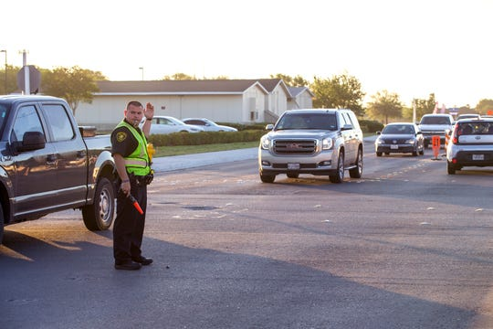 An officer with the Corpus Christi Police Department directs traffic at Everhart Road and Yorktown Boulevard on April 10, 2019. The bond 2014 project is scheduled to be complete by the end of April after nearly two years  of work. The original completion date was set for October 2018.