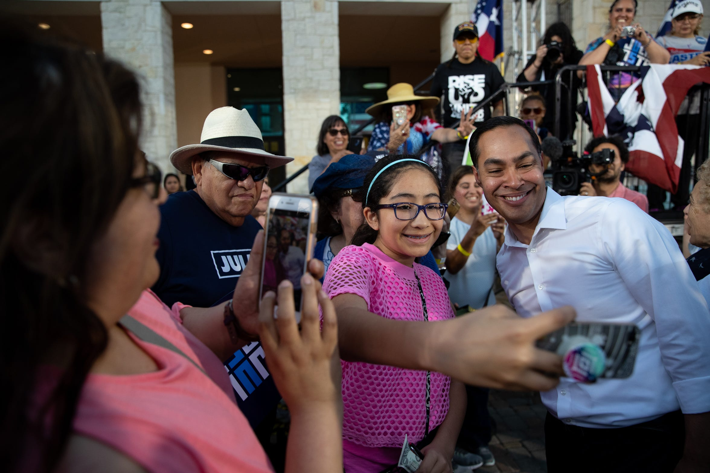 Presidential candidate Julian Castro makes a selfie with a young girl after his People First rally in San Antonio, Texas on Wednesday, April 10, 2019. Earlier in the day President Trump hosted a fundraiser in San Antonio.