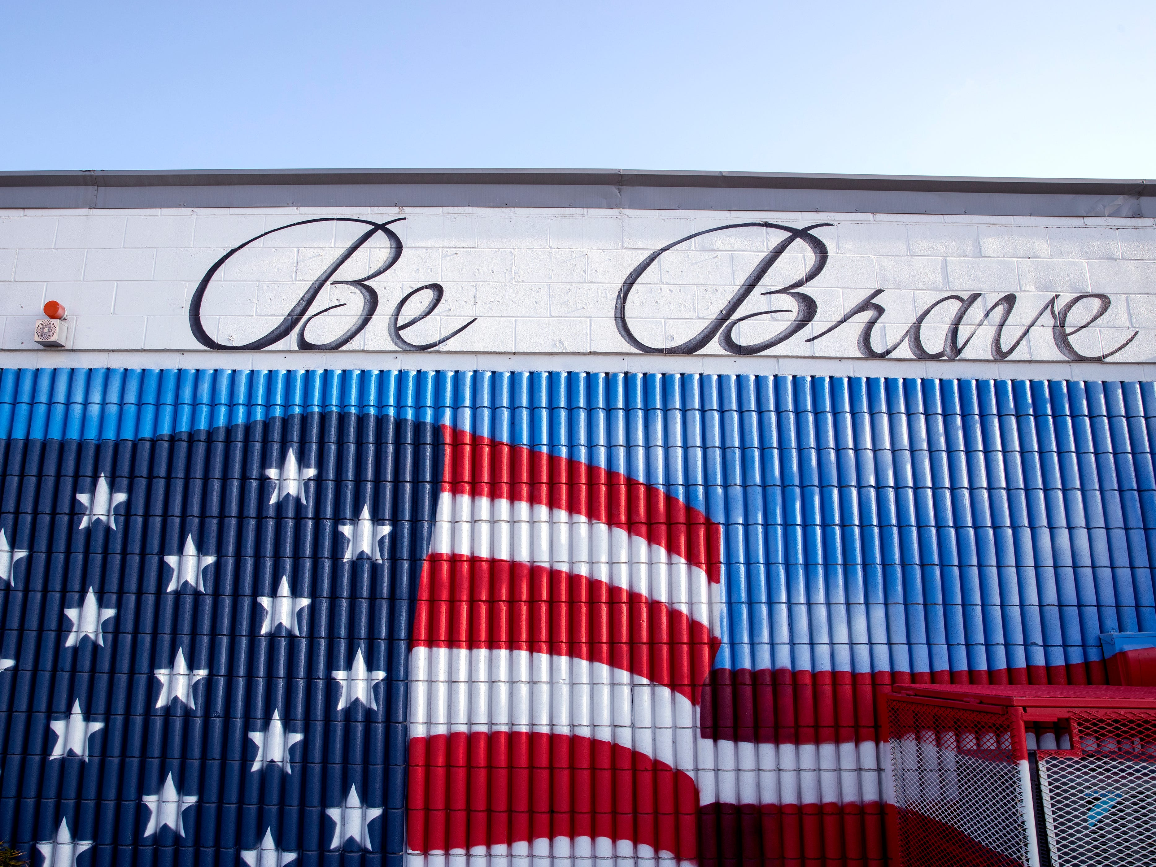 "A mural on the side of a building at 1902 Morgan Ave. encourages people to ""Be Kind and Be Brave."""