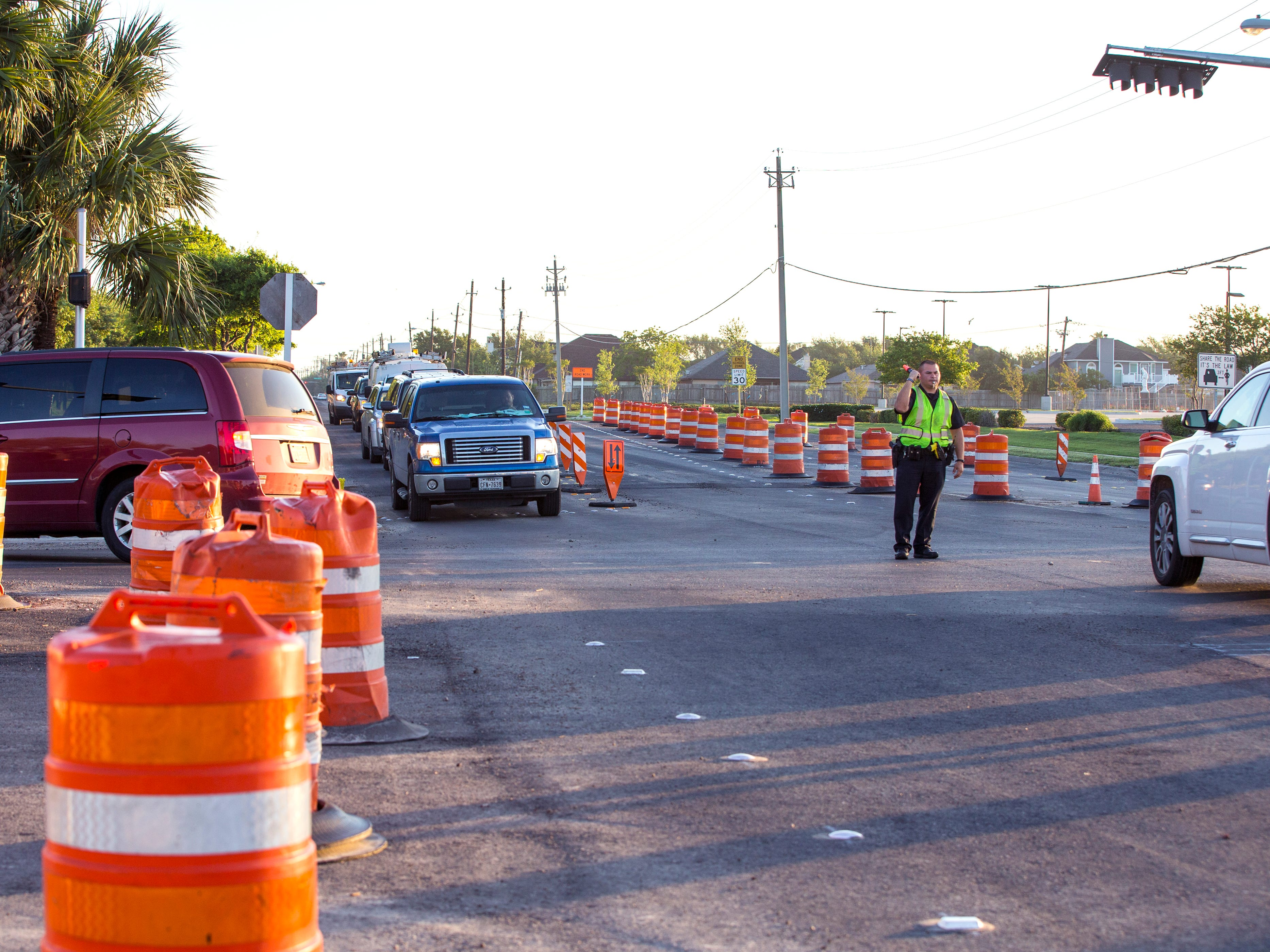 An officer with the Corpus Christi Police Department directs traffic at Everhart Road and Yorktown Boulevard on April 10, 2019. Construction is scheduled to be complete by the end of April after nearly two years  of work. The original completion date was set for October 2018.