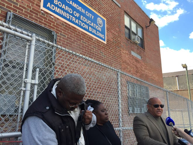 Activist Amir Khan (right), Camden City Council candidate Vida Neil Rosiji and Camden County NAACP President Kevin Barfield address reporters outside Camden School District headquarters.