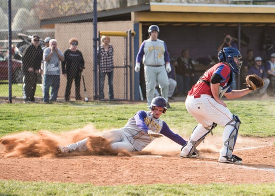 Unioto's Josh Lambert slides into home to score for Unioto Wednesday night. Unioto defeated Zane Trace 8-3.
