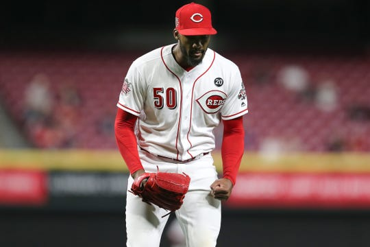 Cincinnati Reds relief pitcher Amir Garrett (50) reacts after striking Miami Marlins second baseman Starlin Castro (13) (not pictured) in the eighth inning of an MLB baseball game, Wednesday, April 10, 2019, at Great American Ball Park in Cincinnati.