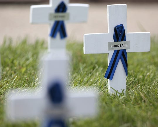 A cross and ribbon noted the sacrifice of Cincinnati Police Officer Charles D. Burdsall killed in the line of duty in 1978.