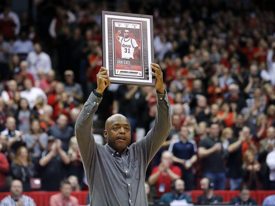 Former Cincinnati Bearcats guard Nick Van Exel is recognized in the second half during the college basketball game between the Memphis Tigers and the Cincinnati Bearcats Thursday, Feb. 23, 2017, at Fifth Third Arena in Cincinnati.