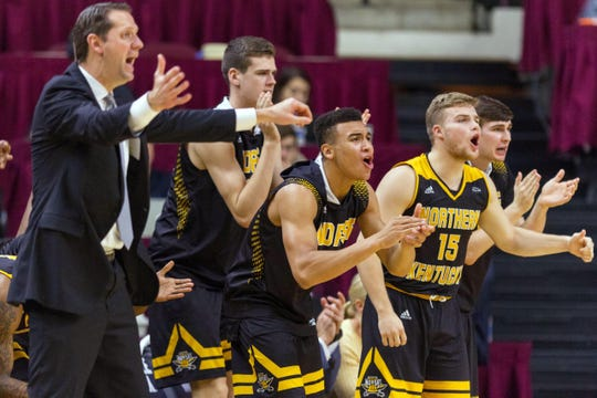 Dec 19, 2017; College Station, TX, USA; Northern Kentucky Norse head coach John Brannen and center Chris Vogt (33) and guard Paul Djoko (2) and guard Tyler Sharpe (15) celebrate a three-pointer against the Texas A&M Aggies in the second half at Reed Arena. Mandatory Credit: C. Morgan Engel-USA TODAY Sports