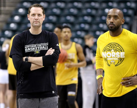 Northern Kentucky Unviersity head coach John Brannen, left, and assistant coach Tim Morris watch their team run drills at Bankers Life Fieldhouse in Indianapolis Thursday March 16, 2017. NKU earned the No. 15 seed in the South Region and will play No. 2-seed Kentucky in the opening round of the NCAA Men's Basketball Championship in Indianapolis on Friday.