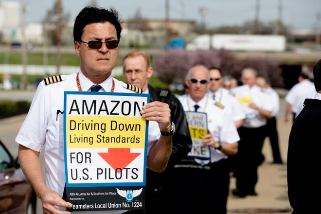 Ray Griffith, an Atlas Pilot, walks with other Teamster Local Union No. 1224 members in an informational picket to raise concerns about stalled contract negotiations and operation concerns at ATSG holding companies subsidiaries and Atlas Air World Wide Holdings on Thursday April 11, 2019, in Florence, Ky.