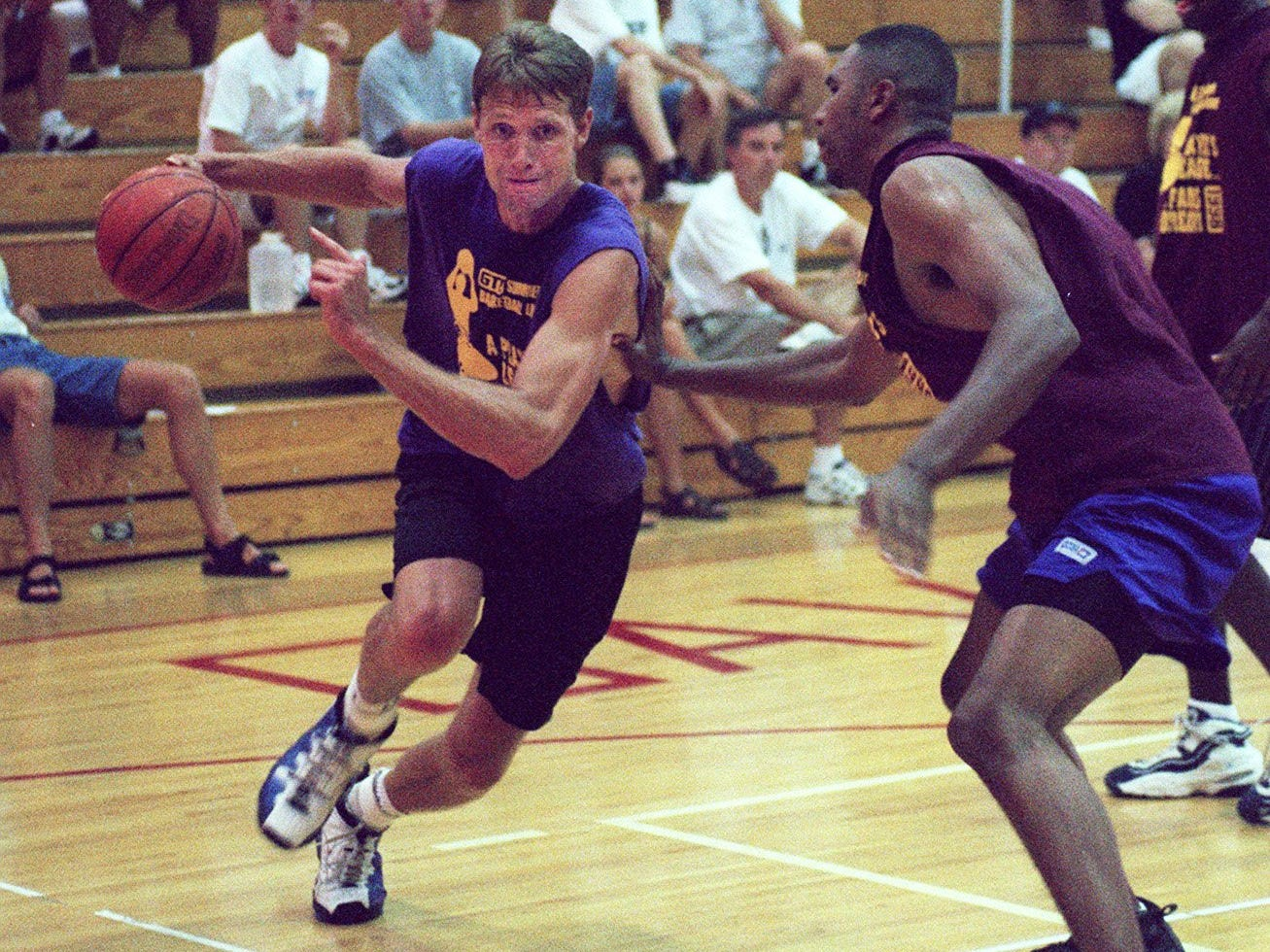 Text: 1998.0711.03.2 PURCELL SPORTS John Brannen playing on the the McCluskey drives the ball around Danon Flint during game action of the GTESummer League Tournament at Purcell Marian High School in East Walnut Hills. PHOTO BY Tony Jones / Cincinnati Enquirer.tj