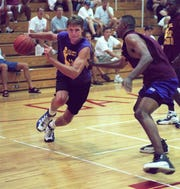 John Brannen drives the ball around Damon Flint during game action of the GTESummer League Tournament at Purcell Marian High School on July 11, 1998.