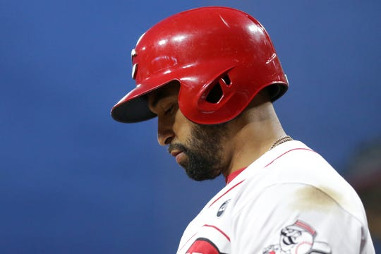 Cincinnati Reds designated hitter Matt Kemp (27) waits at the top of the steps of the dugout in the third inning of an MLB baseball game, Wednesday, April 10, 2019, at Great American Ball Park in Cincinnati.