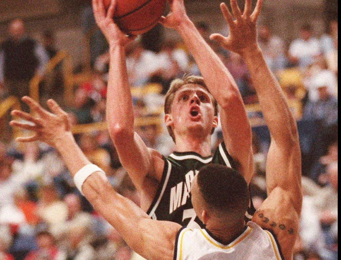 -  -Marshall's John Brannen (33) puts up a jump shot over Tennessee-Chattanooga's Chris Mimms Saturday, Feb. 22, 1997 in Chattanooga, Tenn. (AP Photo/Jaime Oppenheimer)