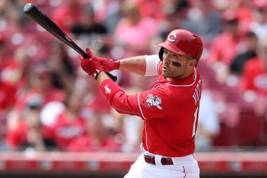 Cincinnati Reds first baseman Joey Votto (19) singles in the fourth inning of an MLB baseball game against the Miami Marlins, Thursday, April 11, 2019, at Great American Ball Park in Cincinnati.