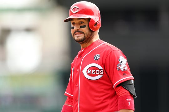 Cincinnati Reds third baseman Eugenio Suarez (7) reacts toward the dugout after reaching first base on a in-field single in the second inning of an MLB baseball game against the Miami Marlins, Thursday, April 11, 2019, at Great American Ball Park in Cincinnati.