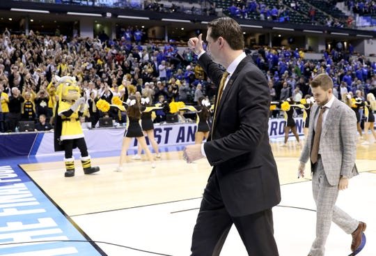 Northern Kentucky head coach John Brannen gives a thumbs up to the Norse fans after losing to UK 79-70 in the first round of the NCAA Men's Basketball Championship in Indianapolis on Friday March 17, 2017.