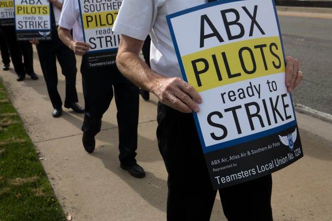 Amazon and DHS contract pilots from Teamster Local Union No. 1224 march in an informational picket to raise concerns about stalled contract negotiations and operation concerns at ATSG holding companies subsidiaries and Atlas Air World Wide Holdings on April 11 in Florence.