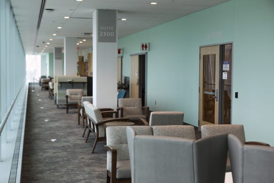 UC Gardner Neuroscience Institute's waiting areas are open with non-reflective surfaces and sun shades for those with light-sensitivity. Each seating area has access to power outlets for phones and other devices.