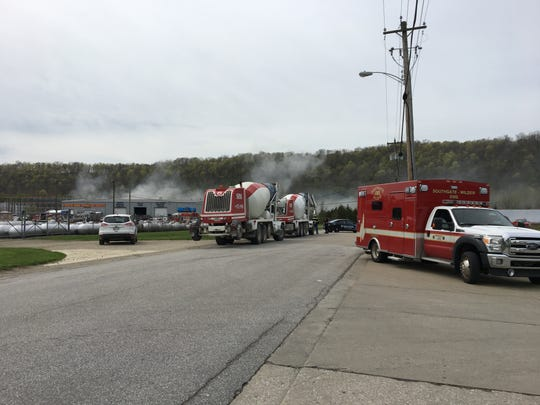 Smoke from a tire fire begins to subside as fire crews extinguish the scene of a tire fire April 11, 2019, behind Bray Truck & Parts in Wilder. An ambulance is on scene as a precaution. No injuries have been reported.