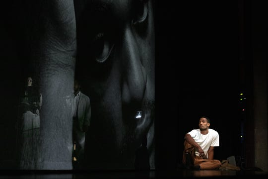 """A scene from an Ann Arbor production of Bryce Dessner's """"Triptych (Eyes of One on Another),"""" the composer's reflection of the tumultuous period in 1990 when Cincinnati's Contemporary Arts Center was charged with pandering obscenity because of an exhibition of photos by Robert Mapplethorpe. The Cincinnati Opera production will take place in the Taft Theatre in April 2020."""
