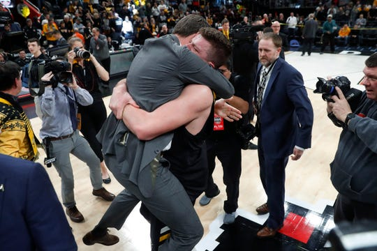 Northern Kentucky coach John Brannen and player Drew McDonald celebrate the team's 77-66 win against Wright State in an NCAA college basketball game for the Horizon League men's tournament championship in Detroit, Tuesday, March 12, 2019. (AP Photo/Paul Sancya)