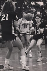 MARCH 4, 1986: Oak Hills girls basketball player Sue Wilkymacky (no. 21) receives a pass from Lori Loew (No. 13) while Beavercreek's Laurie Jackson (No. 40) looks on.