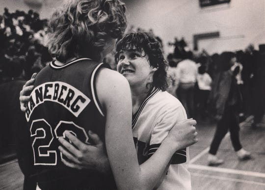 MARCH 8, 1986: Seton's Janet Maneberg congratulates Oak Hills' Mary Ann Richardson after the Highlanders upset the Saints 60-58. Richardson had 15 points.