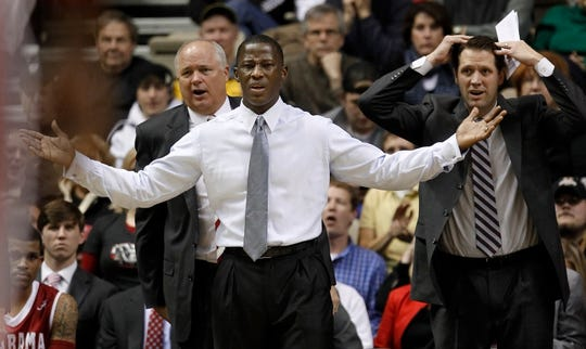 Alabama coach Anthony Grant, center, associate head coach Dan Hipsher, left, and assistant coach John Brannen, right, react to an official's call in the first half of an NCAA college basketball game against Vanderbilt on Thursday, Feb. 10, 2011, in Nashville, Tenn. (AP Photo/Mark Humphrey)