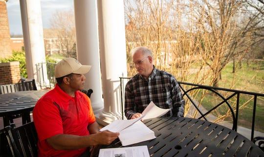 Joe Shakeenab and Jeff Bagley, both 28-year Army veterans, discuss the stories they're working on in Writing for Military and Families, a class offered at Austin Peay through the Community School of the Arts.