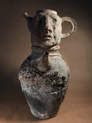 """Canopic Urn: Those Who Decant, Do,"" wood-fired stoneware with incised and cast elements by Auguste Elder."