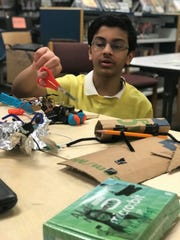 Students from Woodrow Wilson Middle School in Edison were tasked to build a prototype gadget to solve a problem in their community as part of Tata Consultancy Services' goIT program. Pictured is student Sanjay Ravishankar, designing and building his own Micro:Bit-powered gadget.