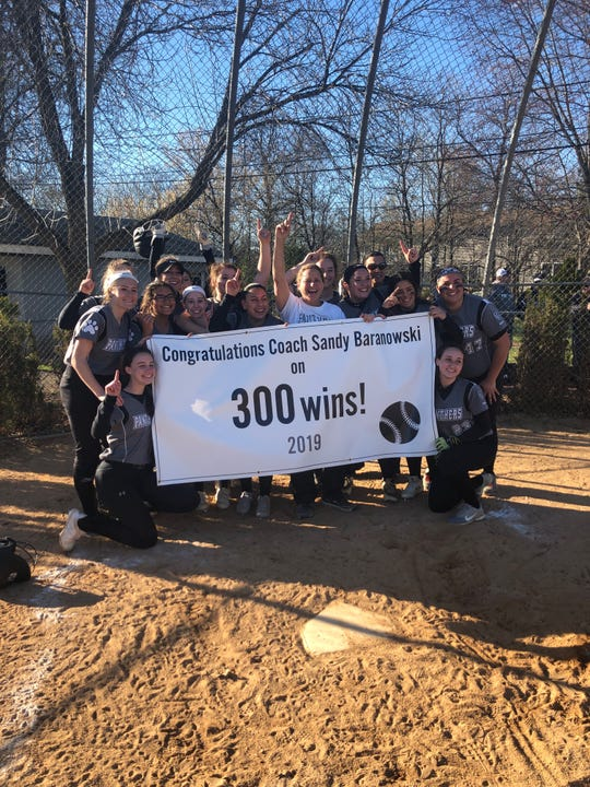 Sandy Baranowski and the Bridgewater-Raritan softball team celebrate the coach's 300th career victory