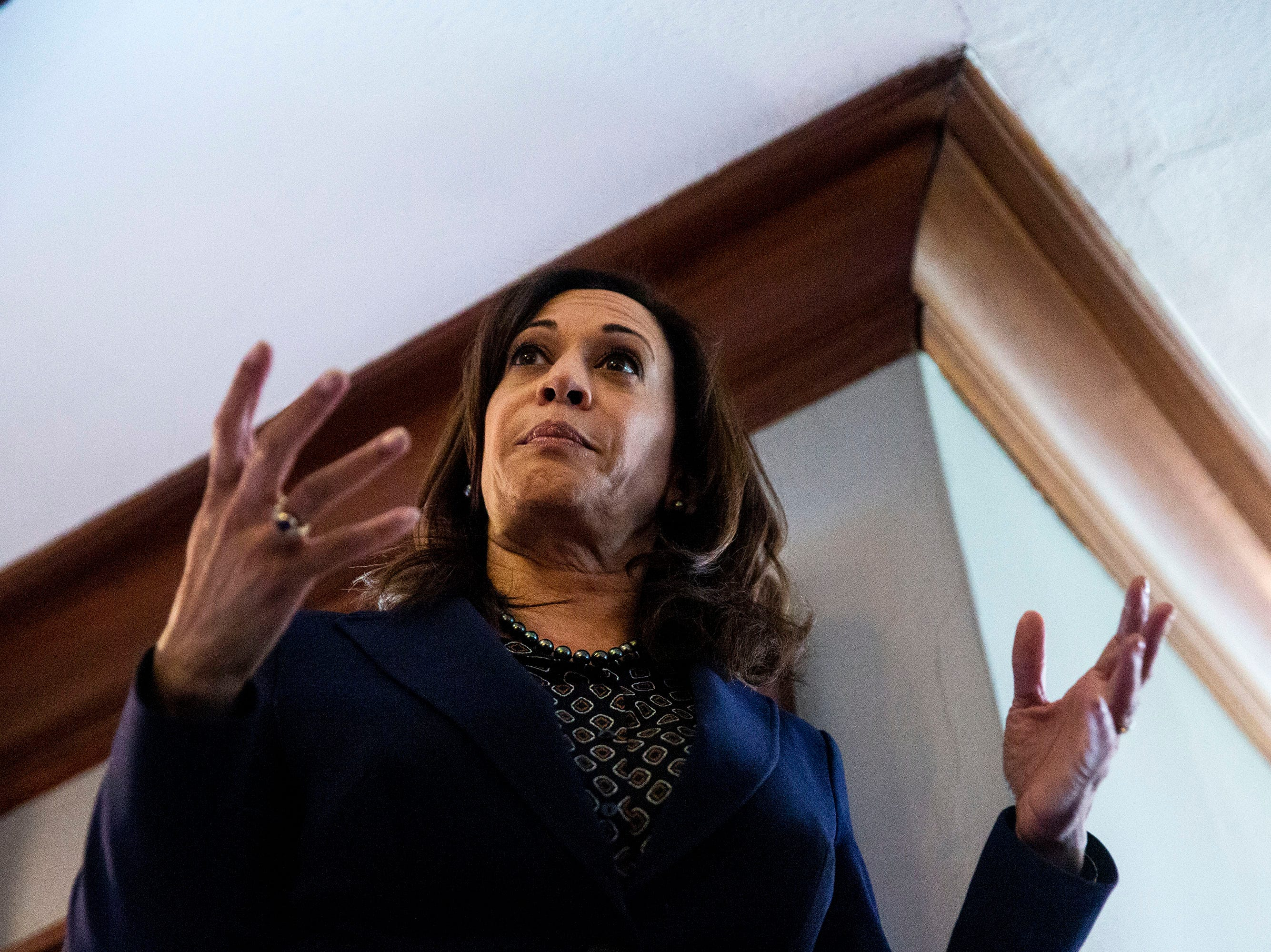 Sen. Kamala Harris, D-CA, speaks to a crowd of people at a house party on Thursday, April 11, 2019, in Des Moines.