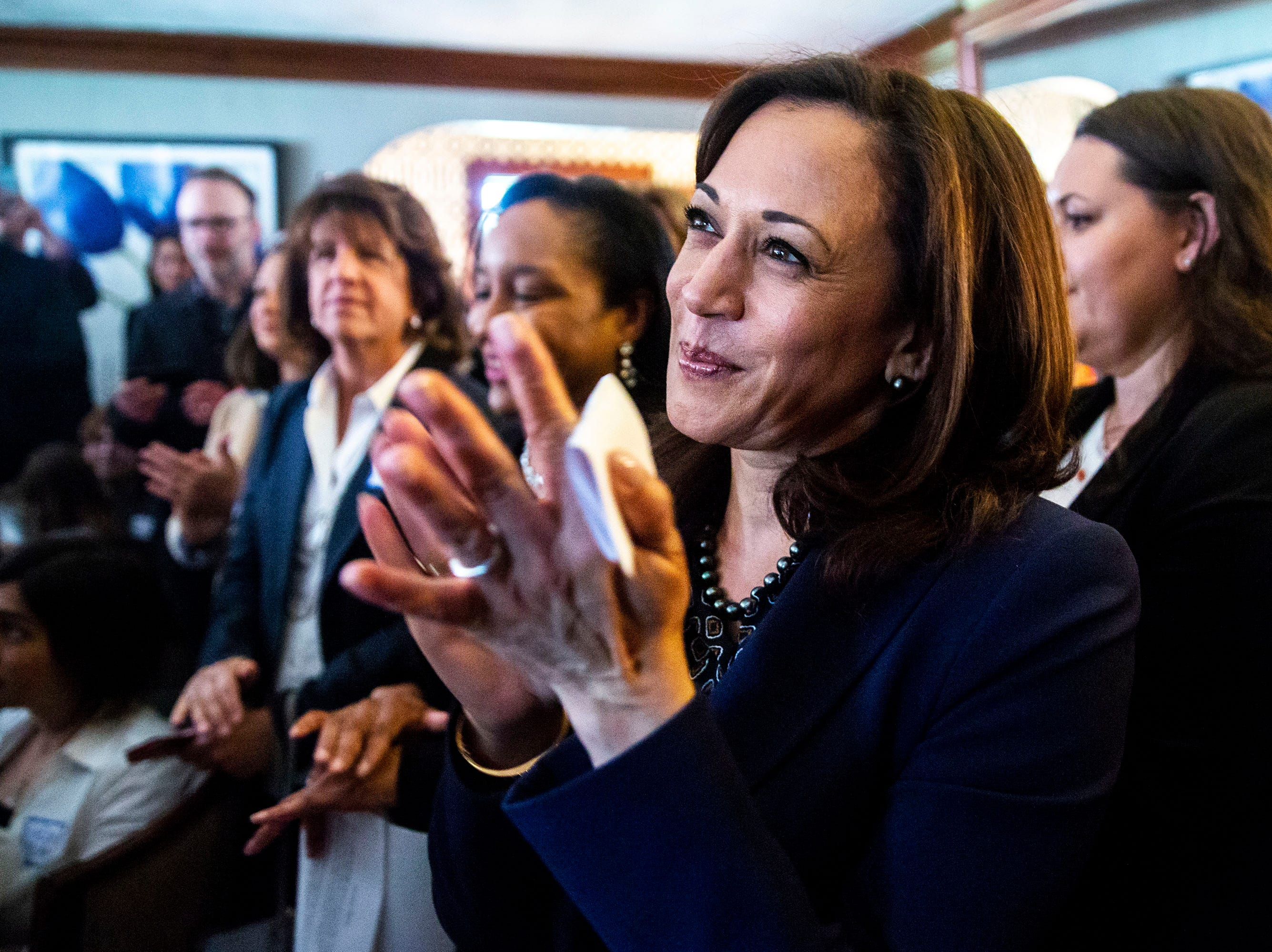 Sen. Kamala Harris, D-CA, waits to be introduced to speak during a house party on Thursday, April 11, 2019, in Des Moines.