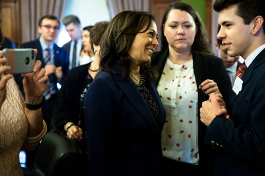 Sen. Kamala Harris, D-CA, meets with a group of young people who work at the Iowa Captiol on April 11 in Des Moines.